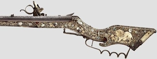 Richly engraved and inlaid early flintlock